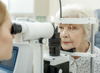 Ophthalmologist performing eye examination.