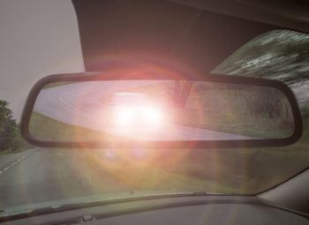 Headlight glare in rear view mirror. Night vision loss.
