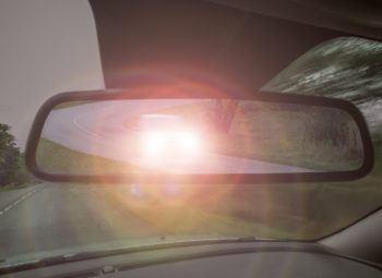 Headlight glare in rear view mirror. Night vision loss.