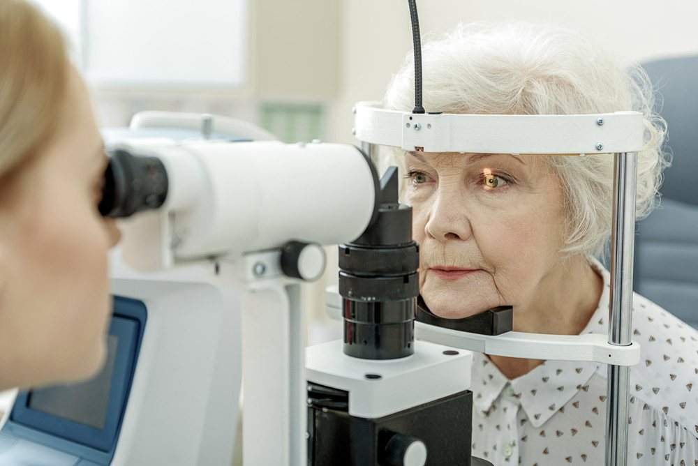 Ophthalmologist performing eye examination.