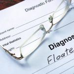 Document containing eye floaters diagnosis information with eyeglasses