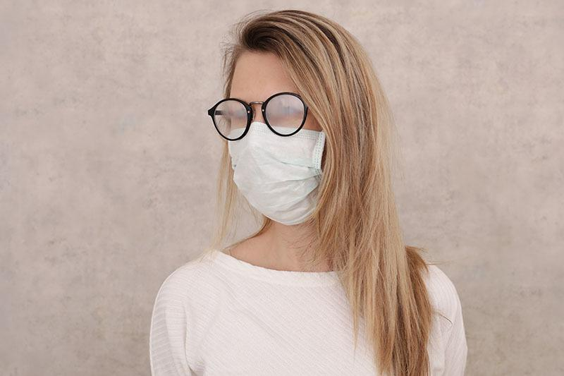 women wearing a face mask with foggy glasses during covid-19