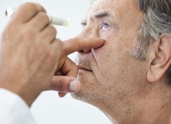 Man gets an eye exam to view the progression of cataracts